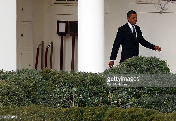 S President Barack Obama leaves the Oval Office of the White House January 12 2010 in Washington DC President Obama and first lady Michelle Obama are...