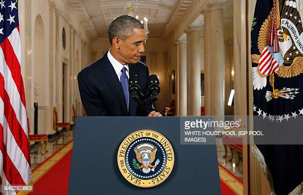 US President Barack Obama leaves the podium after announcing executive actions on US immigration policy during a nationally televised address from...