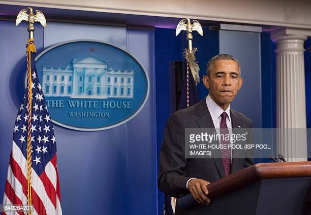 President Barack Obama leaves the podium after speaking on the shooting at Oregon's Umpqua Community College at the White House in Washington DC on...