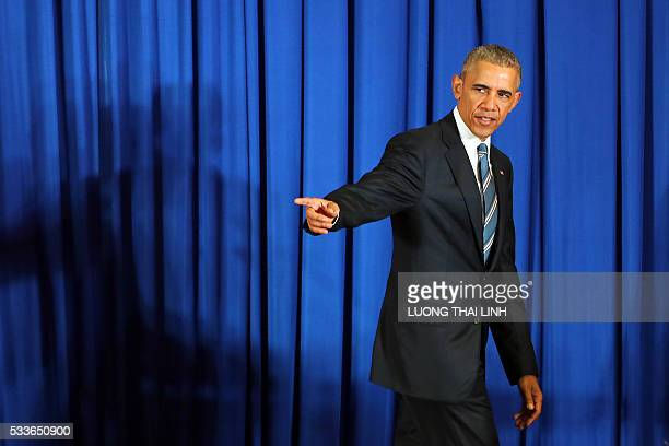 President Barack Obama leaves the stage after a joint press conference with his Vietnamese counterpart at the International Convention Center in...