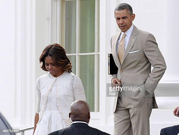 S President Barack Obama leaves the White House with first lady Michelle Obama to attend a church service April 20 2014 in Washington DC Obama and...