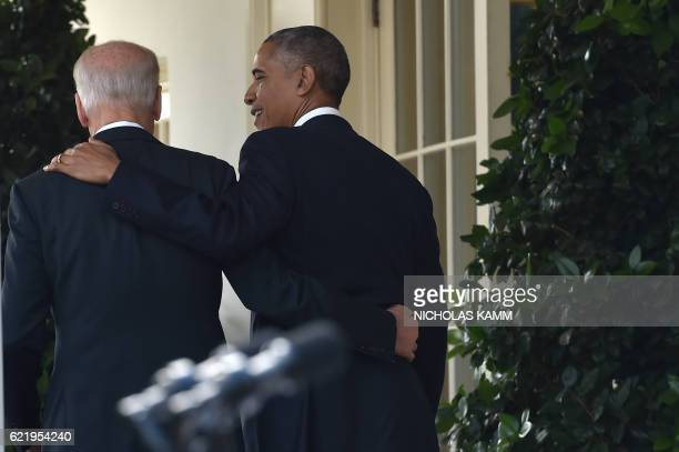 President Barack Obama leaves together with Vice President Joe Biden after he addressed the nation publicly for the first time since the shock...