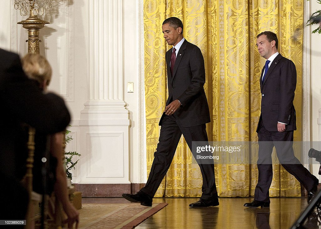 U.S. President Barack Obama, left, and Dmitry Medvedev, Russia's president, arrive for a joint news conference at the White House in Washington, D.C., U.S., on Thursday, June 24, 2010. Obama said the U.S. and Russia are committed to expanding commercial ties, and Medvedev said he wants to remove all obstacles to trade and investment in his country. Photographer: Joshua Roberts/Bloomberg via Getty Images