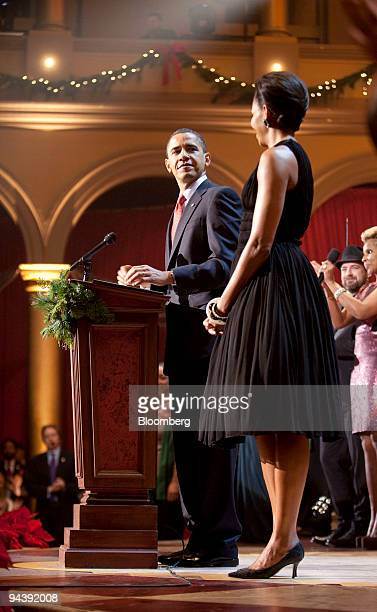 US President Barack Obama left and First Lady Michelle Obama speak at the conclusion of the Christmas in Washington concert at the National Building...