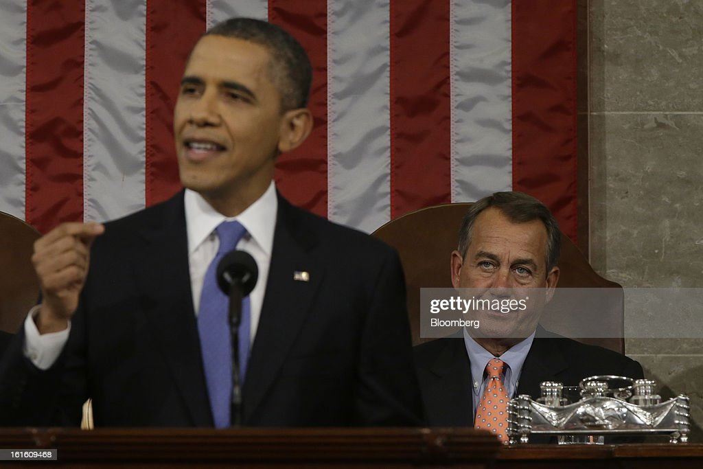 U.S. President Barack Obama, left, delivers the State of the Union address to a joint session of Congress as House Speaker John Boehner, a Republican from Ohio, right, looks on at the Capitol in Washington, D.C., U.S., on Tuesday, Feb. 12, 2013. Obama called for raising the federal minimum wage to $9 an hour and warned he'll use executive powers to get his way on issues from climate change to manufacturing if Congress doesn't act, laying out an assertive second-term agenda sure to provoke Republicans. Photographer: Charles Dharapak/Pool via Bloomberg