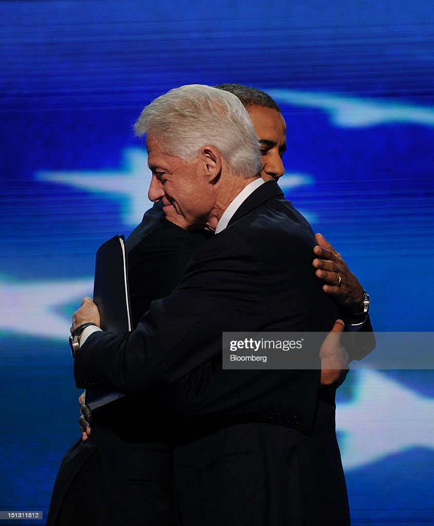 U.S. President Barack Obama, left, embraces former U.S. President Bill Clinton on stage during day two of the Democratic National Convention (DNC) in Charlotte, North Carolina, U.S., on Wednesday, Sept. 5, 2012. Democratic officials have moved President Barack Obama's nomination acceptance speech tomorrow night to the Time Warner Cable Arena from the larger, outdoor Bank of America Stadium because of the possibility of severe weather. Photographer: Daniel Acker/Bloomberg via Getty Images
