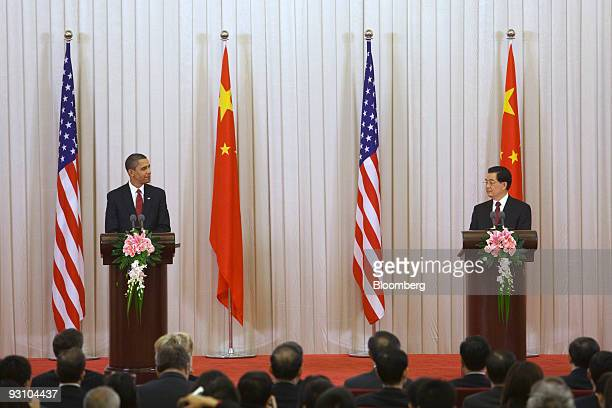 US President Barack Obama left issues a joint press statement with Hu Jintao China's president in Beijing China on Tuesday Nov 17 2009 Obama and Hu...