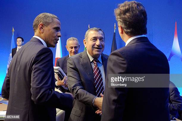 US President Barack Obama left speaks as Essam Sharaf Egypt's prime minister second right shakes hands with David Cameron UK prime minister right...