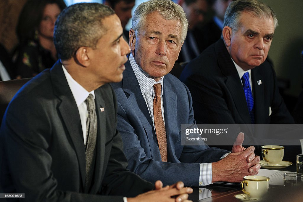 U.S. President Barack Obama, left, speaks during a cabinet meeting with Chuck Hagel, secretary of defense, center, and Ray LaHood, secretary of transportation, at the White House in Washington, D.C., U.S., on Monday, March 4, 2013. Obama announced three cabinet-level nominations today, choosing Sylvia Mathews Burwell of the Wal-Mart Foundation as director of the Office of Management and Budget, scientist Ernest Moniz as head of the Energy Department, and Gina McCarthy to lead the Environmental Protection Agency, where she's been an assistant administrator. Photographer: Pete Marovich/Bloomberg via Getty Images