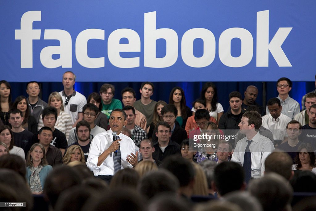 U.S. President Barack Obama, left, speaks while Mark Zuckerberg, co-founder and chief executive officer of Facebook Inc., smiles during a town hall event at Facebook headquarters in Palo Alto, California, U.S., on Wednesday, April 20, 2011. Obama said members of both political parties in Washington need to work together to start reducing the nation's budget deficit in a 'balanced way.' Photographer: David Paul Morris/Bloomberg via Getty Images