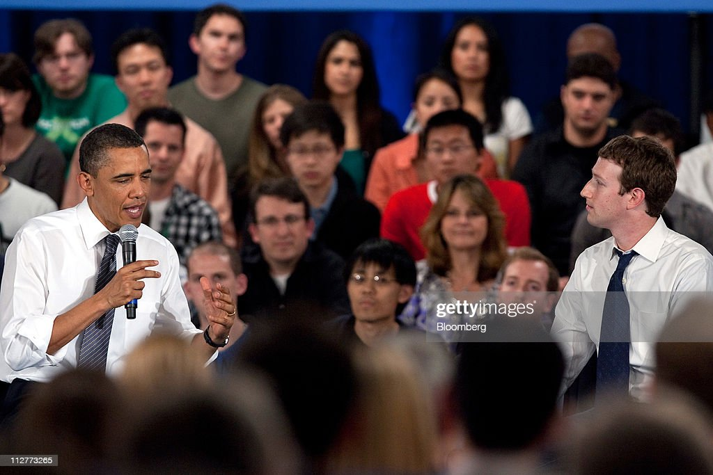 U.S. President Barack Obama, left, speaks while Mark Zuckerberg, co-founder and chief executive officer of Facebook Inc., listens during a town hall event at Facebook headquarters in Palo Alto, California, U.S., on Wednesday, April 20, 2011. Obama said members of both political parties in Washington need to work together to start reducing the nation's budget deficit in a 'balanced way.' Photographer: David Paul Morris/Bloomberg via Getty Images