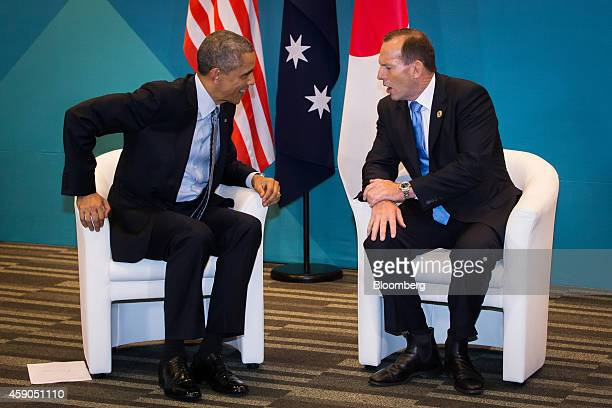 US President Barack Obama left speaks with Tony Abbott Australia's prime minister during a trilateral meeting at the Group of 20 summit in Brisbane...