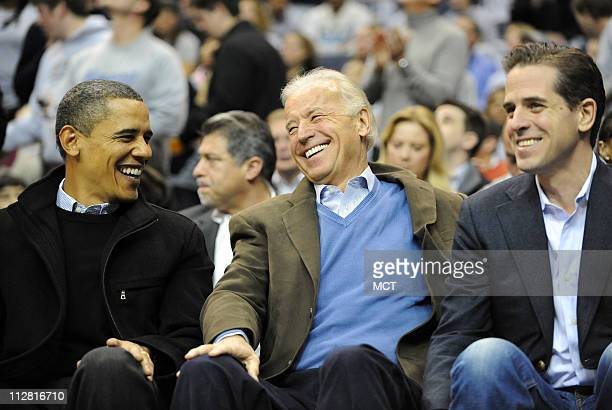 President Barack Obama left Vice President Joe Biden center and Hunter Biden share a laugh during the first half of the NCAA basketball game between...