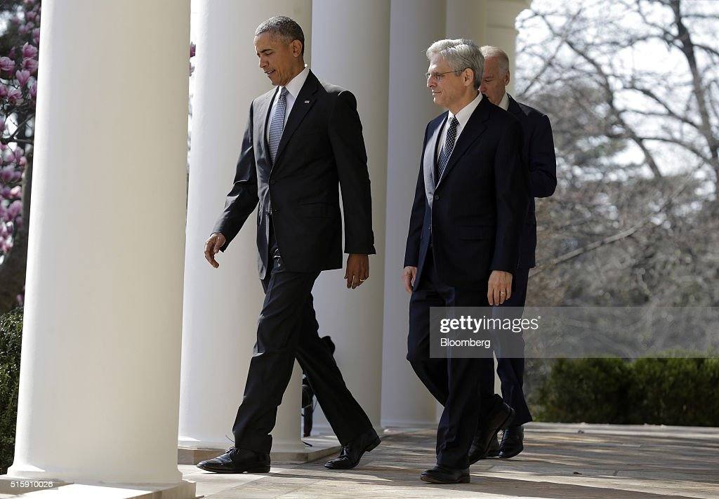 U.S. President Barack Obama, left, walks towards the Rose Garden with his nominee for the Supreme Court, Merrick Garland, chief judge for the U.S. Court of Appeals for the District of Columbia Circuit, center, and Vice President Joseph 'Joe' Biden at the White House in Washington, D.C., U.S., on Wednesday, March 16, 2016. The nomination escalates a battle that will dominate the final 10 months of Obamas presidency, as the White House is locked in an unprecedented dispute with Senate Republican leaders who have pledged to ignore the presidents choice. Photographer: Joshua Roberts/Bloomberg via Getty Images