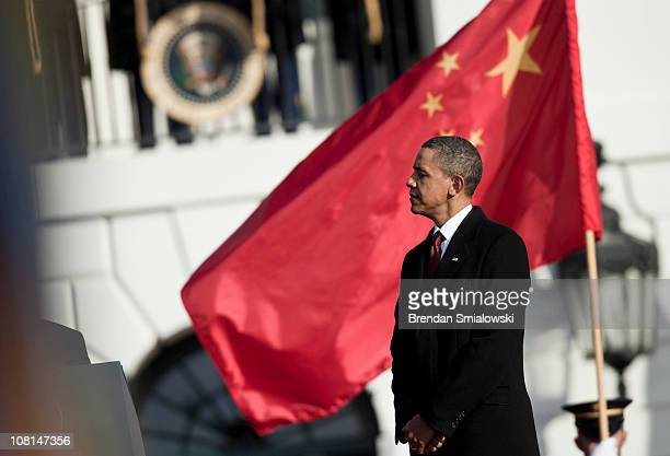 S President Barack Obama listens as Chinese President Hu Jintao speaks during a state arrival ceremony on the South Lawn of the White House January...