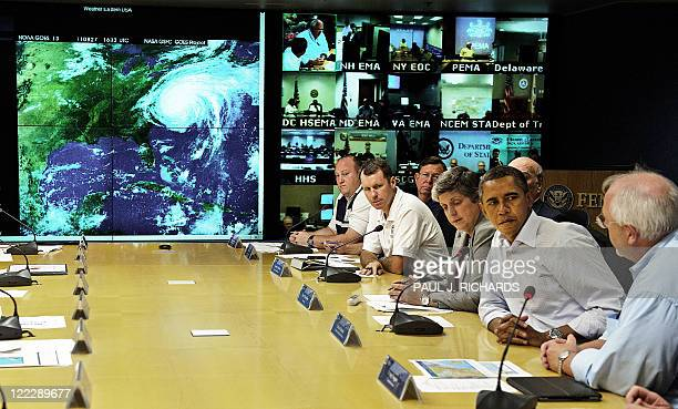 President Barack Obama listens as Federal Emergency Management Agency Administrator Craig Fugate updates representatives from various US safety...