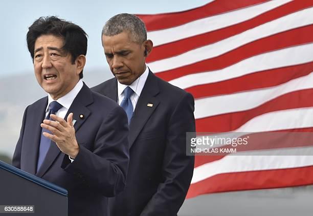 US President Barack Obama listens as Japanese Prime Minister Shinzo Abe speaks at the USS Arizona Memorial on December 27 2016 at Pearl Harbor in...