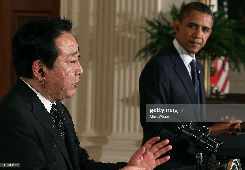 U.S. President Barack Obama (R) listens as Japanese Prime Minister Yoshihiko Noda speaks during a news conference in the East Room at the White House on April 30, 2012 in Washington, DC. President Obama and Prime Minister Noda took questions from the media and talked about US-Japanese relations and their strong alliance.
