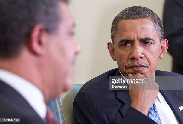 US President Barack Obama listens as Leonel Fernandez president of the Dominican Republic speaks after a bilateral meeting in the Oval Office of the...