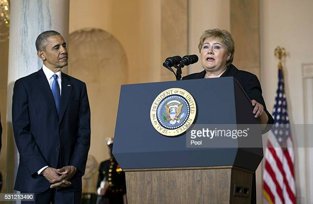 President Barack Obama listens as Norway Prime Minister Erna Solberg delivers remarks during an an arrival ceremony for Nordic leaders in the Grand...
