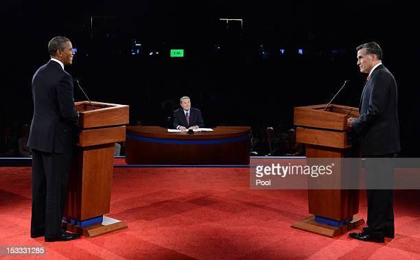 S President Barack Obama listens as Republican presidential candidate and former Massachusetts Gov Mitt Romney speaks during the Presidential Debate...