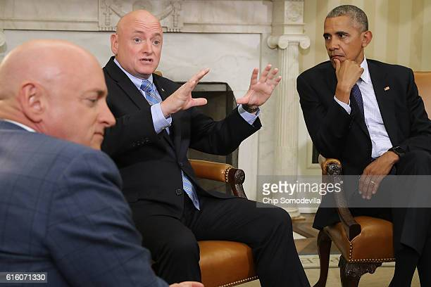 President Barack Obama listens as retired NASA astronaut Scott Kelly as he talks about seeing China from space follwing a meeting in the Oval Office...