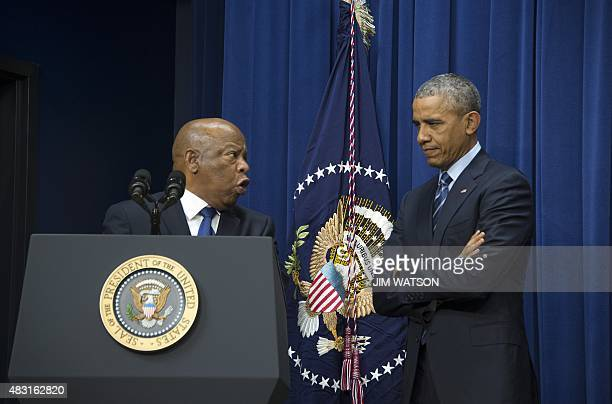 US President Barack Obama listens as US Congressman John Lewis DGeorgia delivers remarks marking the 50th anniversary of the Voting Rights Act in...