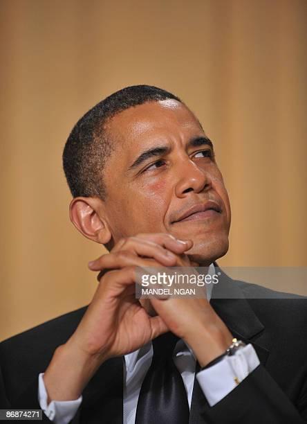 President Barack Obama listens as White House Correspondents' Association President Jennifer Loven of the Associated Press speaks at the White House...