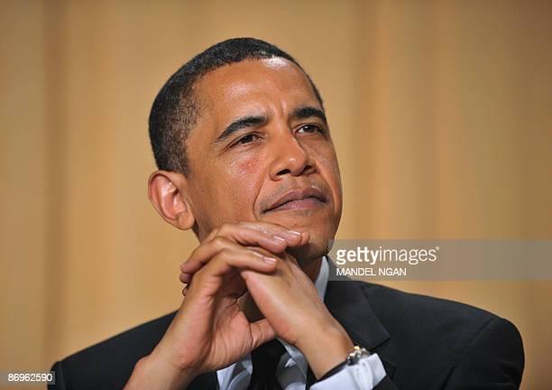 President Barack Obama listens as White House Correspondents' Association President Jennifer Loven of the Associated Press speak at the White House...