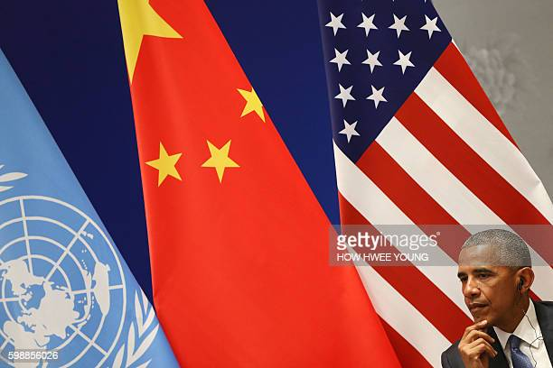 US President Barack Obama listens during a joint ratification of the Paris climate change agreement with Chinese President Xi Jinping ahead of the...