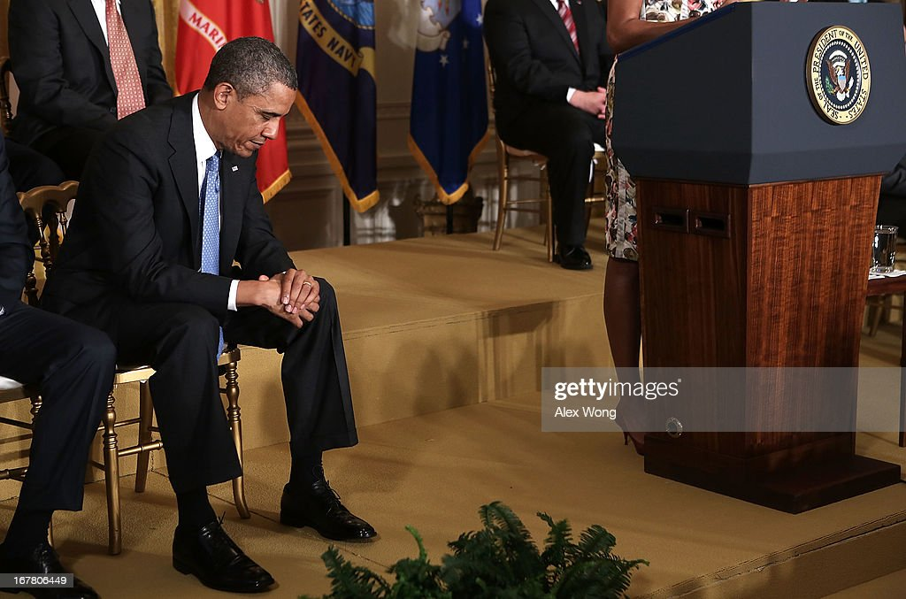 U.S. President Barack Obama listens during a veterans employment event in the East Room April 30, 2013 at the White House in Washington, DC. Michelle Obama and Jill Biden encousrged the private sector to step up the hiring of veterans.