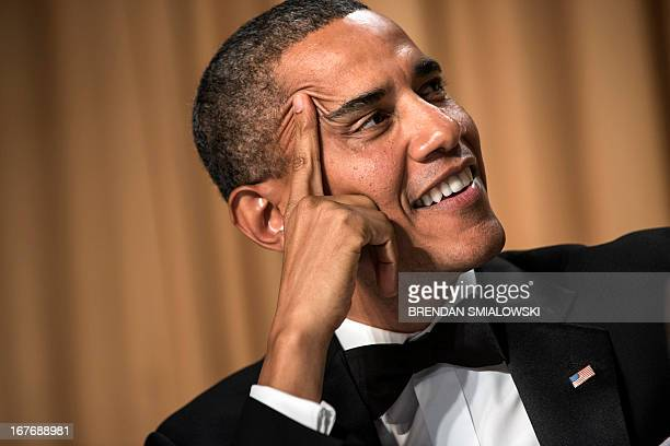 US President Barack Obama listens during the White House Correspondents' Association Dinner April 27 2013 in Washington DC Obama attended the yearly...