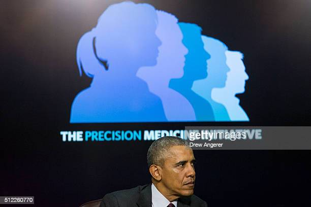 S President Barack Obama listens during the White House Precision Medicine Initiative Summit in the South Court Auditorium in the Eisenhower...