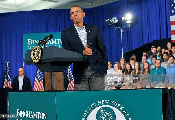 US President Barack Obama listens to a question during a town hall meeting at Binghamton University on August 23 2013 in Binghamton New York Obama is...