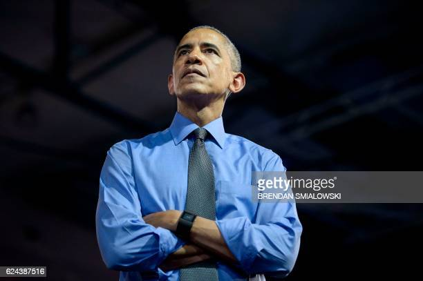 US President Barack Obama listens to a question during a Young Leaders of the Americas Initiative town hall meeting at the Pontifical Catholic...