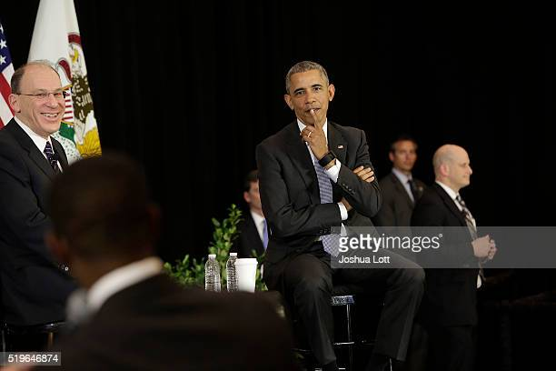 President Barack Obama listens to a question from an attendee at the University of Chicago Law School as Law Professor David Strauss looks on April 7...