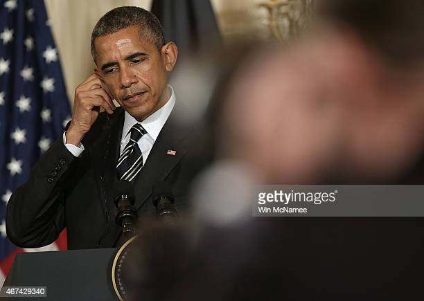 President Barack Obama listens to a question while holding a joint press conference with President of Afghanistan Ashraf Ghani in the East Room of...