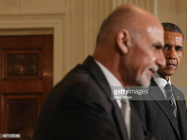 President Barack Obama listens to Afghan President Ashram Ghani speak during a news conference in the East Room at the White House on March 24, 2015...