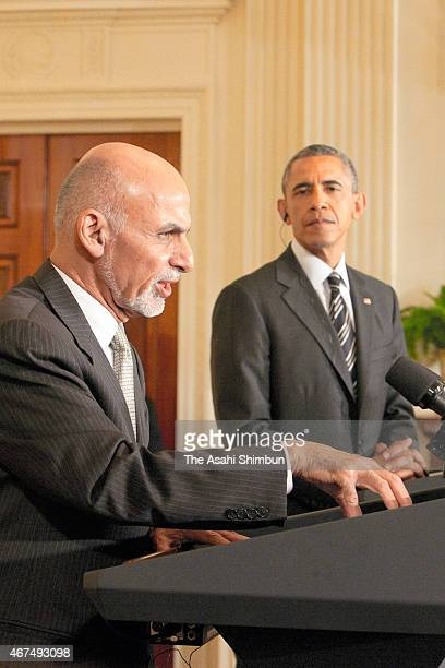 President Barack Obama listens to Afghan President Ashram Ghani speak during a news conference in the East Room at the White House in March 24, 2015...