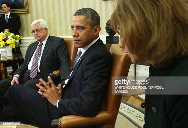 US President Barack Obama listens to an interpreter as he meets with Palestinian President Mahmoud Abbas in the Oval Office of the White House March...