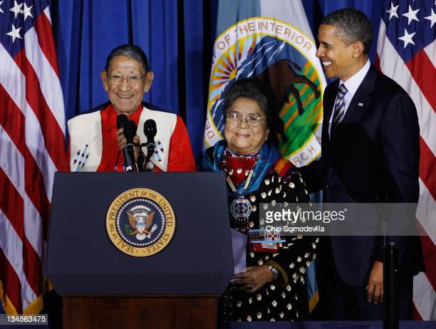 S President Barack Obama listens to his Native American 'adoptive parents' Crow Tribe members Sonny and Mary Black Eagle of Montana say a closing...