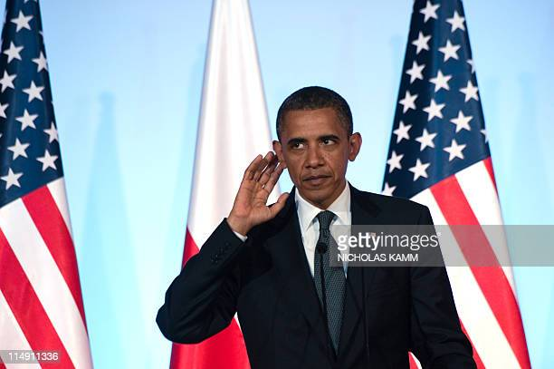 US President Barack Obama listens to journalists questions during a press conference with Polish Prime Minister Donald Tusk following talks at the...