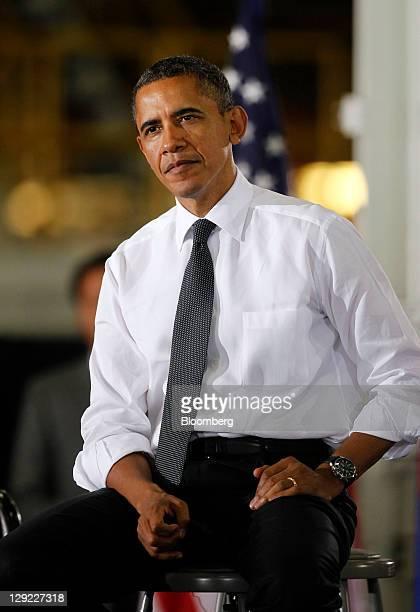 President Barack Obama listens to Lee Myung-bak, president of South Korea, speak during an event at the General Motors Co. Orion Assembly Plant in...