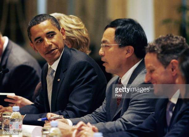 President Barack Obama listens to President Hu Jintao of China speak at a bilateral meeting at the Waldorf Astoria Hotel on September 22, 2009 in New...