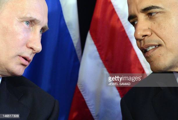 President Barack Obama listens to Russian President Vladimir Putin after their bilateral meeting in Los Cabos, Mexico on June 18, 2012 on the...