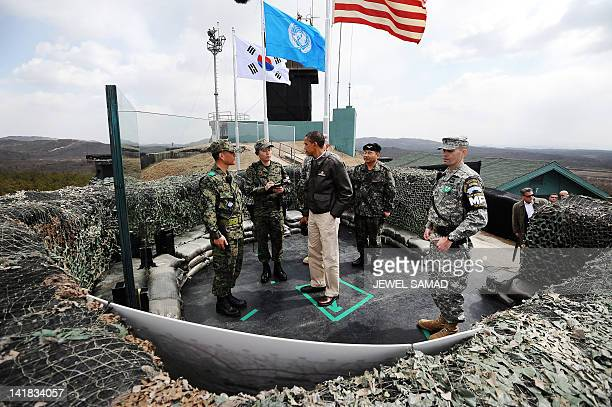 US President Barack Obama listens to South Korean officers at Observation Post Ouellette during a visit to the Joint Security Area of the...