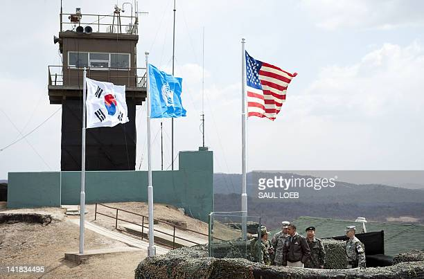 US President Barack Obama listens to South Korean soldiers at Observation Post Ouellette during a visit to the Joint Security Area of the...
