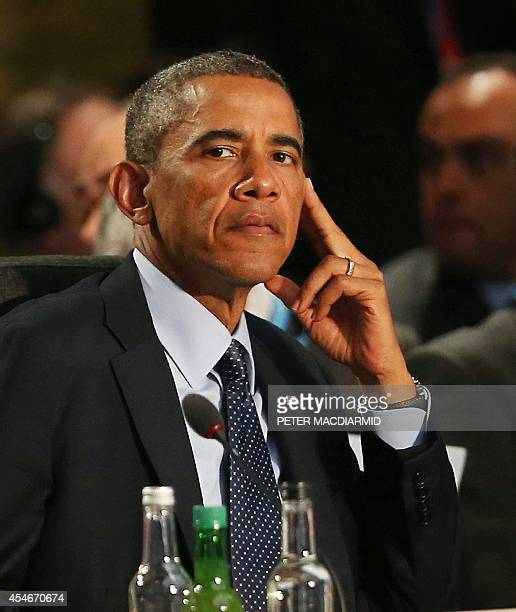 President Barack Obama listens to speeches on the second day of the 2014 NATO Summit in Newport, Wales, on September 5, 2014. British Prime Minister...