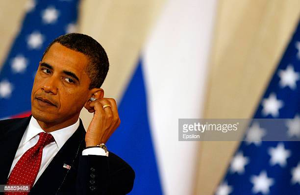 S President Barack Obama listens to translation during a press conference with Russian President Dmitry Medvedev after the signing ceremony of the...