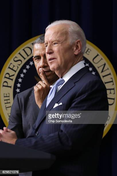 S President Barack Obama listens to Vice President Joe Biden deliver remarks before signing the 21st Century Cures Act into law at the Eisenhower...